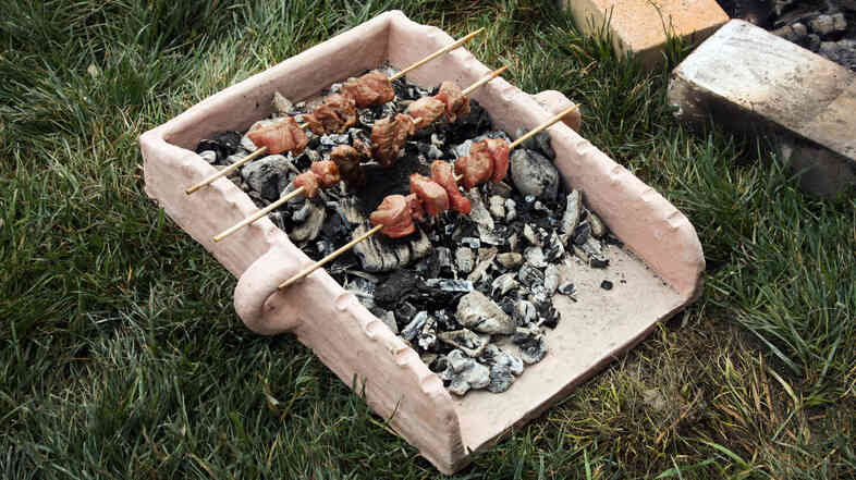 Souvlaki skewers in a replica of a tray the Mycenaeans used to prepare their food in ancient Greece.