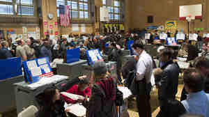 Voters wait for their chance to cast a ballot in the Chelsea neighborhood of Manhattan, Nov. 6, 2012, in New York.