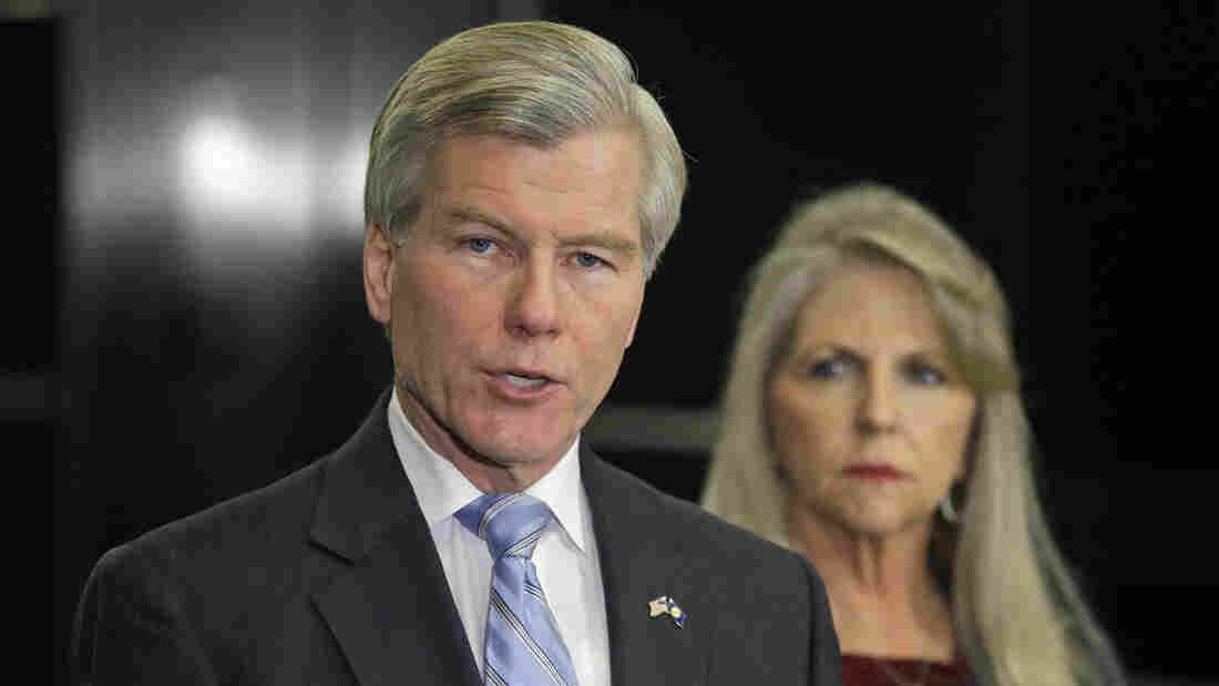 Former Virginia Gov. Bob McDonnell makes a statement as his wife, Maureen, listens during a Tuesday news conference in Richmond, Va.
