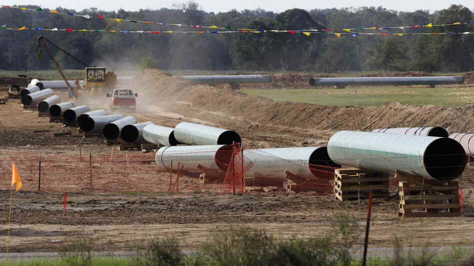 A 2012 photo shows sections of pipe on a neighboring property to Julia Trigg Crawfo