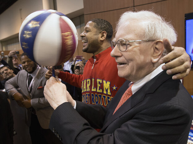 """Warren Buffett with Harlem Globetrotter Chris """"Handles"""" Franklin at Berkshire Hathaway's annual meeting in May 2013."""
