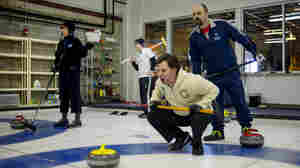 Potomac Curling Club members (from left) Miriam Terninko, Christopher Richard, Joe Rockenbach and Henrique Kempenich await the arrival of stones to the house during a match Jan. 18 at National Capital Curling Center in Laurel, Md.