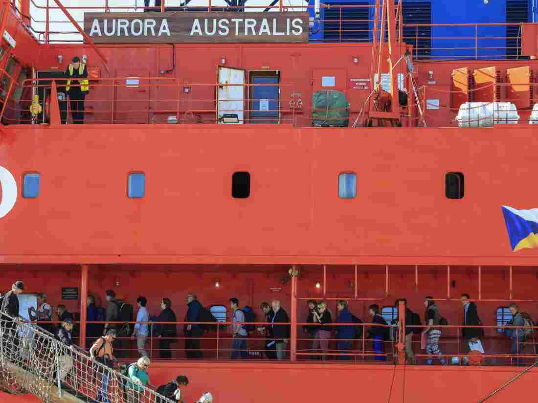 Back home: Passengers disembark from the icebreaker Aurora Australis on Wednesday at a harbor in Hobart, Australia. The ship brought 52 scientists and adventure tourists back to Australia from Antarctica, where the ship they had been on got stuck in ice.