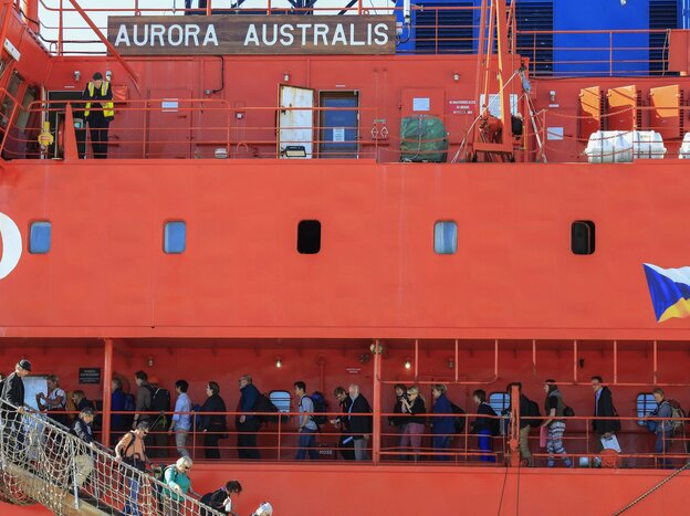 Back home: Passengers disembark from the icebreaker Aurora Australis on Wednesday at a harbor in Hobart, Australia. The ship brought 52 scientists and adventure tourists back to Australia from Antarctica, where the ship they had been on go