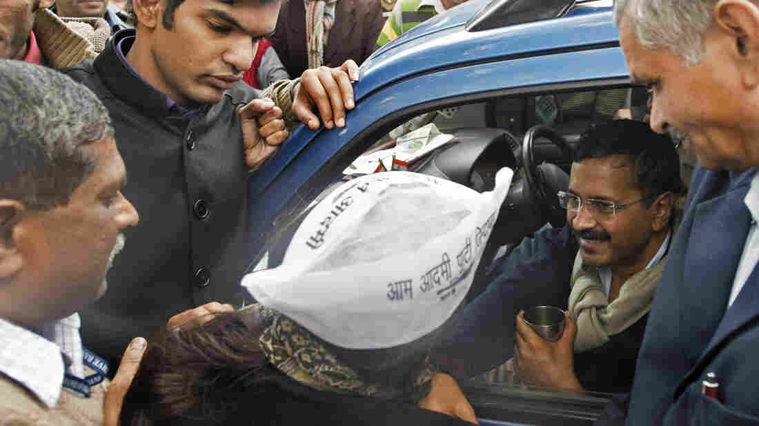 Delhi Chief Minister Arvind Kejriwal (center) greets supporters from his blue wagon, which became a de facto local government headquarters during a two-day protest in New Delhi.