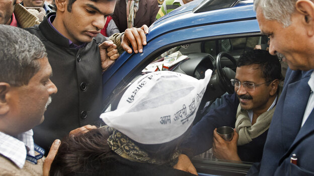 Delhi Chief Minister Arvind Kejriwal (center) greets supporte