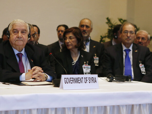 Syrian Foreign Minister Walid Moallem (left) at the peace talks in Montreux, Switzerland, on Wednesday.