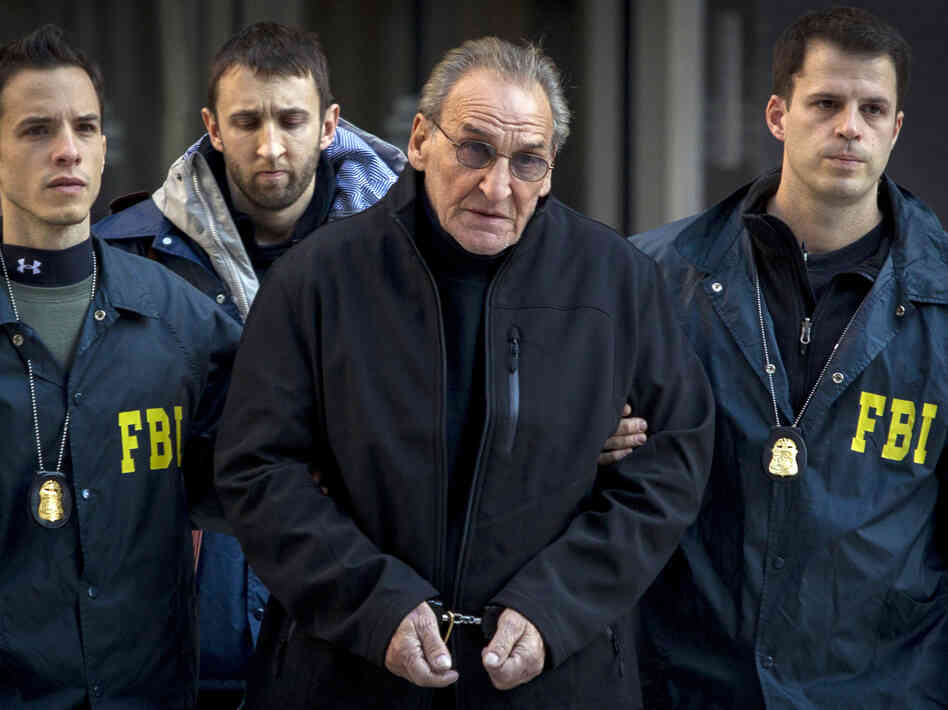 Reputed Bonanno crime family leader Vincent Asaro, 78, is escorted by FBI agents from their Manhattan offices in New York on Thursday.