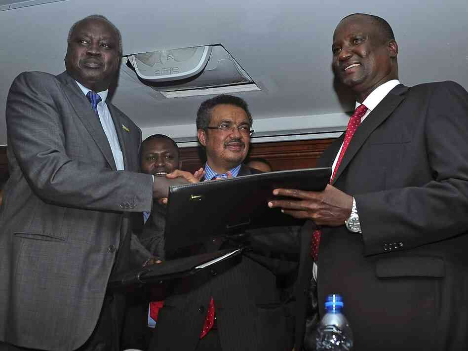 South Sudan's government-delegation leader Nhial Deng Nhial (left) and the rebel-delegation leader Taban Deng Gai shake hands after signing a cease-fire agreement in Addis Ababa, Ethiopia, on Thursday.