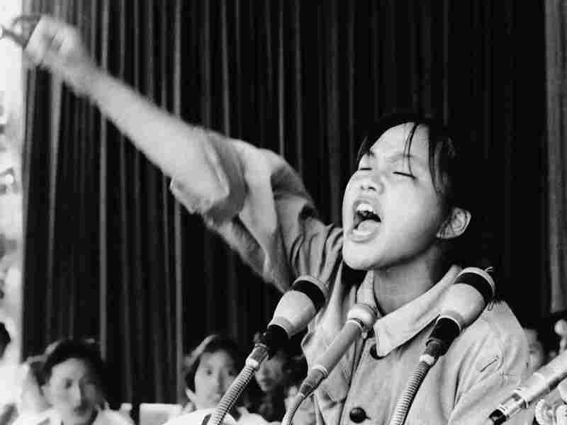 Miss Cho, a 15-year-old high school student and Red Guard leader, exhorts her fellow students during a rally held in Beijing's Tiananmen Square in 1966.