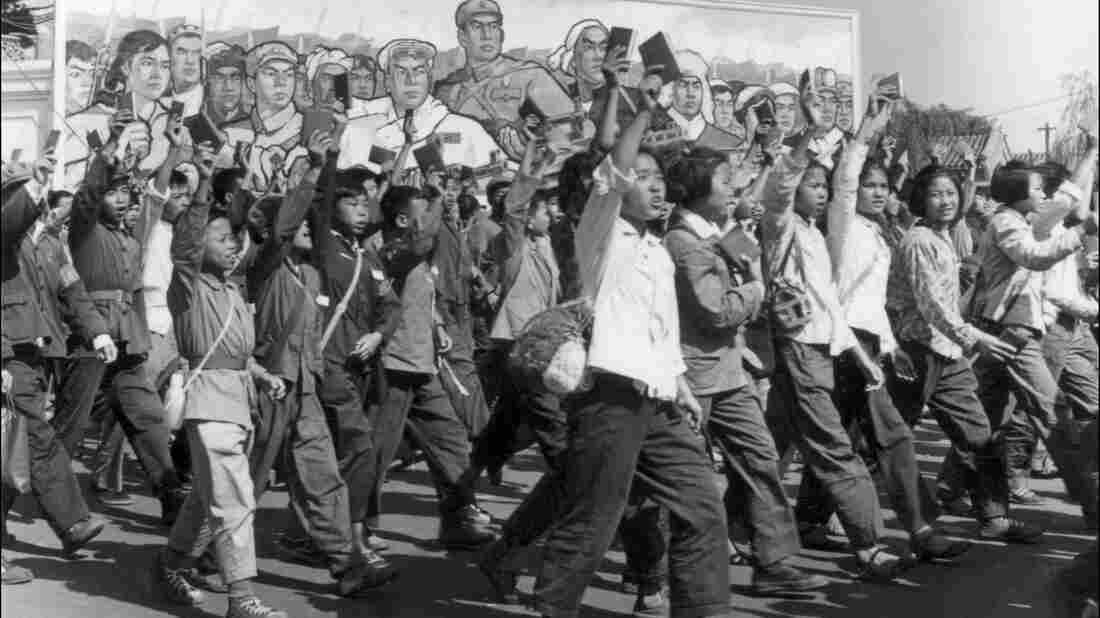 Red Guards — high school and university students — wave copies of Chairman Mao Zedong's Little Red Book during a parade in June 1966 in Beijing's streets at the beginning of China's Cultural Revolution. More than 1 million people are believed to have died during the decade-long upheaval.