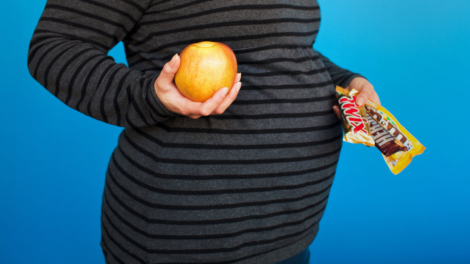 Choose wisely: What Mom eats during pregnancy can set the stage for obesity in her baby. (Meg Vogel/NPR)