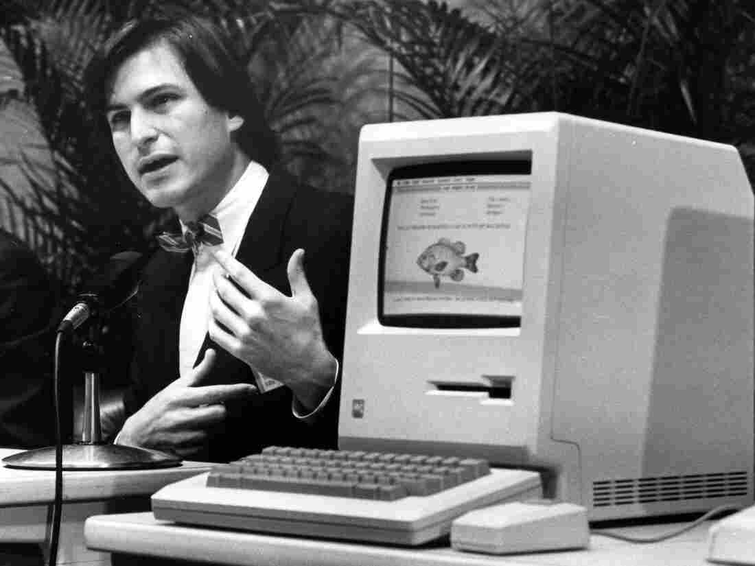 Steve Jobs, the late founder and former CEO of Apple, announces the Apple Macintosh computer at a shareholders meeting on Jan. 24, 1984, in California.