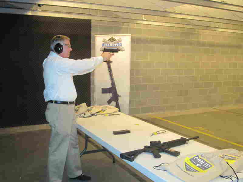 Sen. Lindsey Graham shooting at the Palmetto State Armory in Columbia, S.C., where he appeared at an event this week to promote safety locks on guns.