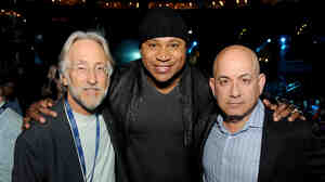 Recording Academy President and CEO Neil Portnow, host LL Cool J and Executive Vice President of Specials, Music and Live Events at CBS Entertainment Jack Sussman pose at the Staples Center in Los Angeles on Jan. 23, a few days before the 2014 Grammy Awards.