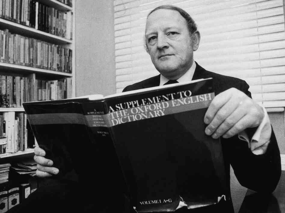 English writer and broadcaster Robert Robinson holding the first volume of A Supplement To The Oxford English Dictionary in 1977.