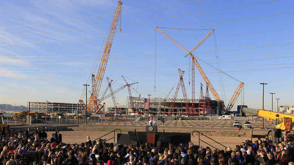 With new construction in the background, President Obama spoke about manufacturing and jobs during a visit to Intel's Ocotillo facility, Jan. 25, 2012, in Chandler, Ariz.