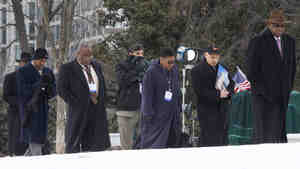Alexandria, Va., Mayor Bill Euille (third from left); Gary, Ind., Mayor Karen Freeman-Wilson (fifth from left); and other mayors walk toward the White House Thursday for a reception with President Obama and Vice President Biden.