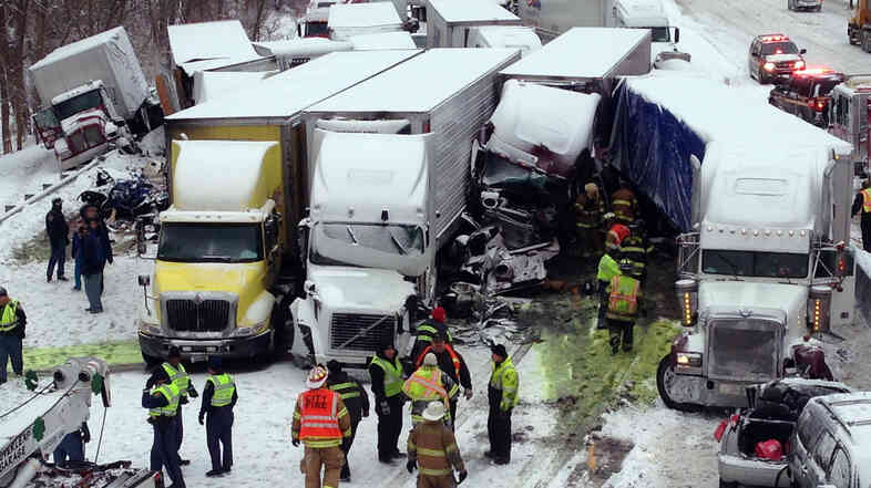 Emergency crews work at the scene of a massive pileup Thursday involving more than 40 vehicles, many of them semitrailers, along Interstate 94.