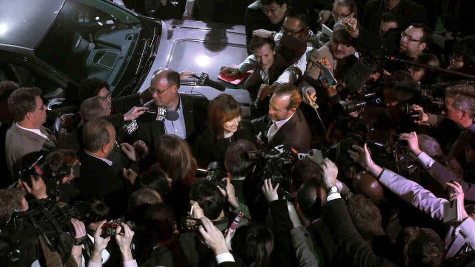 Incoming General Motors CEO Mary Barra at the center of the press scrum during the North American International Auto Show.