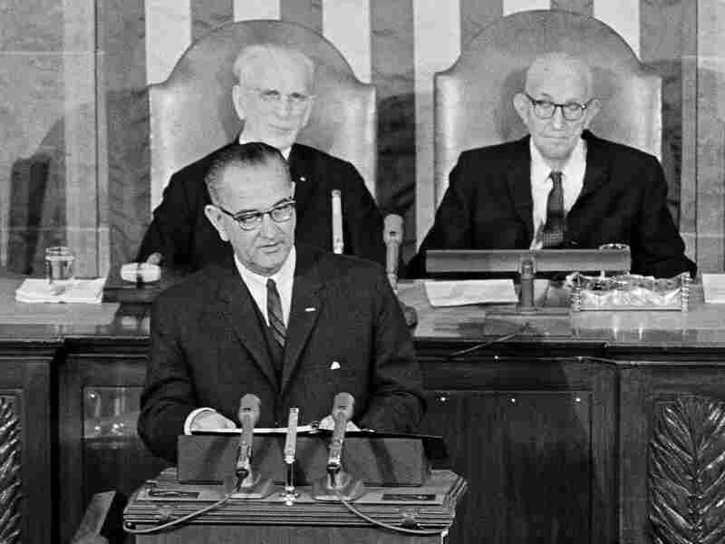 President Lyndon B. Johnson delivers his State of the Union address to a joint session of Congress on Jan. 8, 1964. In the background are Speaker John McCormack and Sen. Carl Hayden, right, Senate president pro tem.