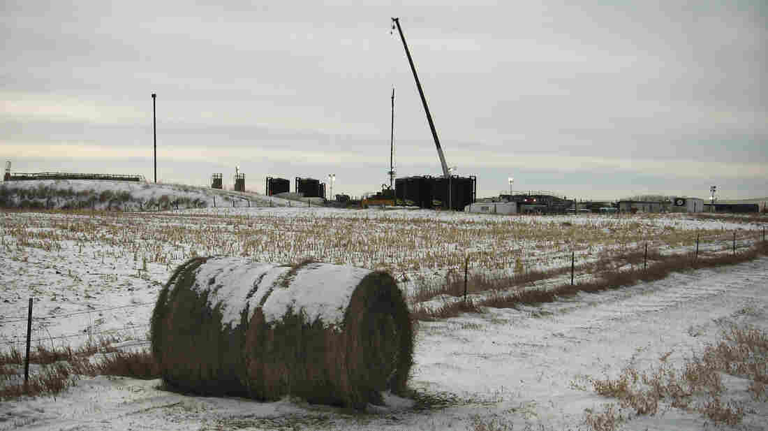 A drilling site rises from the middle of farmland near Fairfield, N.D. Many farmers and ranchers are profiting from the state's oil boom, but others complain that drillers are interfering with their business.
