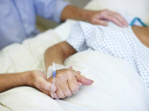 Who will help make decisions when an older family member is hospitalized?