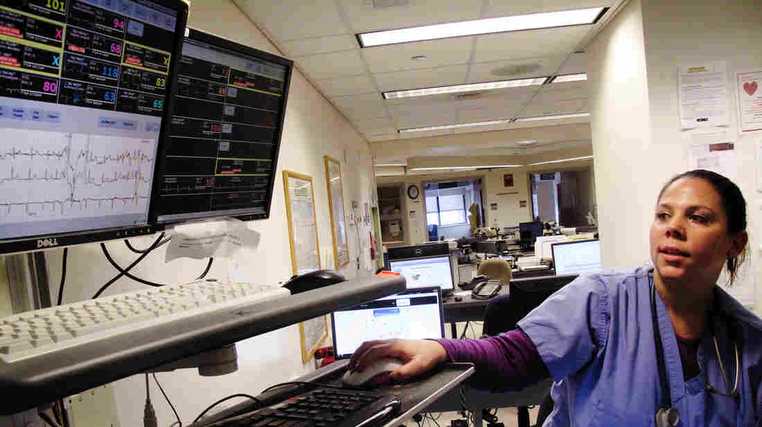 Amanda Gerety, a staff nurse at Boston Medical Center, checks monitors that track patients' vital signs. Fewer beeps means crisis warnings are easier to hear, she says.