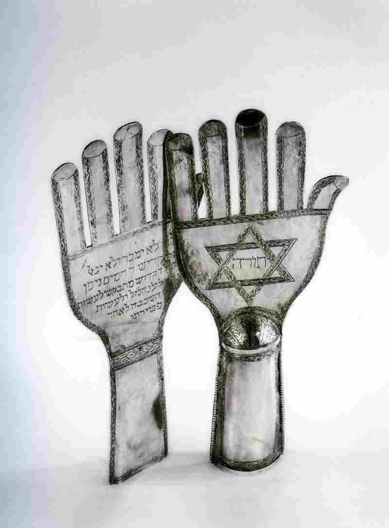 These early 20th-century hand-shaped Torah finials are unique to the Jewish communities of Iran and Iraq and are inspired by hand-shaped banners, called alam, that are carried by Shiite Muslims on the holy day of Ashura.