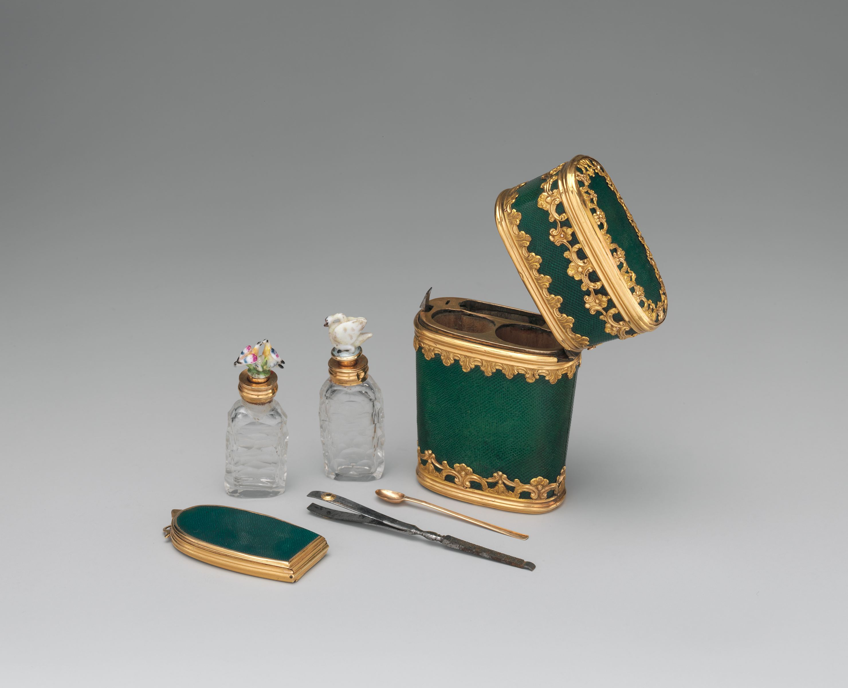 Gold, porcelain, glass and steel compose this 18th-century necessaire from France.