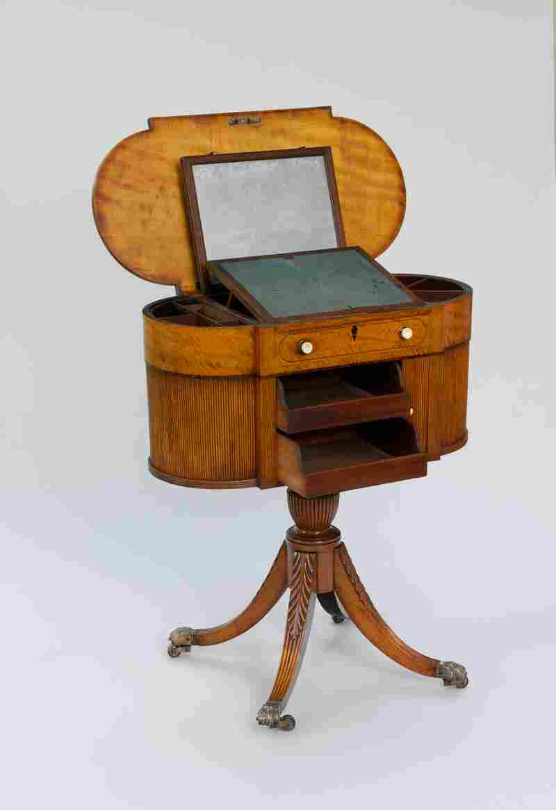 This American worktable was made of satinwood and served as a sewing table and writing desk as well as a vanity.