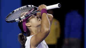 Li Na of China celebrates after defeating Dominika Cibulkova of Slovakia