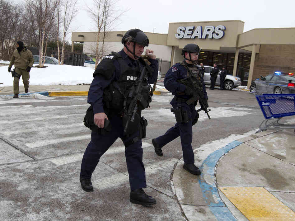 Police move in from a parking lot to the Mall in Columbia after reports of a multiple shooting, on Saturday, in Howard County, Md.