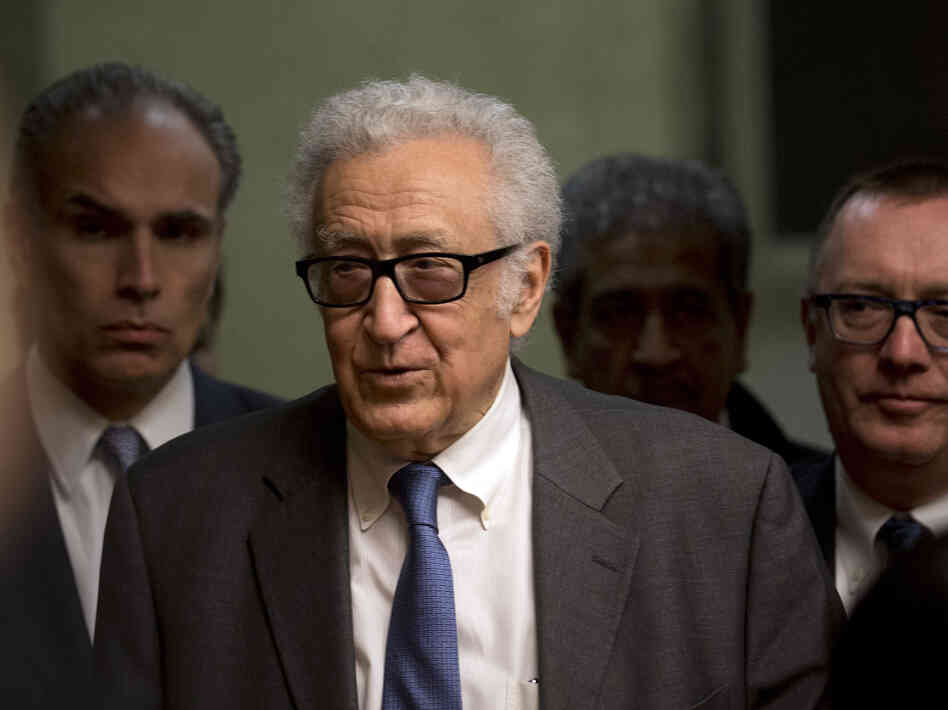 U.N. mediator Lakhdar Brahimi, center, arrives for a press br