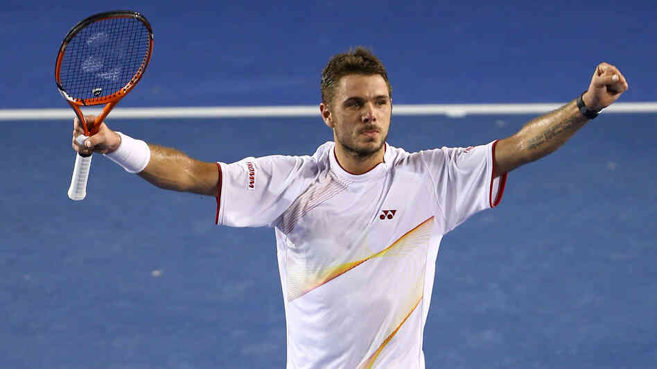 Stanislas Wawrinka of Switzerland celebrates his victory in the men's final match against Rafael Nadal of Spain.