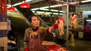 A vendor sells chickens at the Kowloon City Market in Hong Kong last month. As a precautionary measure against the deadly H7N9 virus, Hong Kong has temporarily stopped importing poultry from mainland farms.