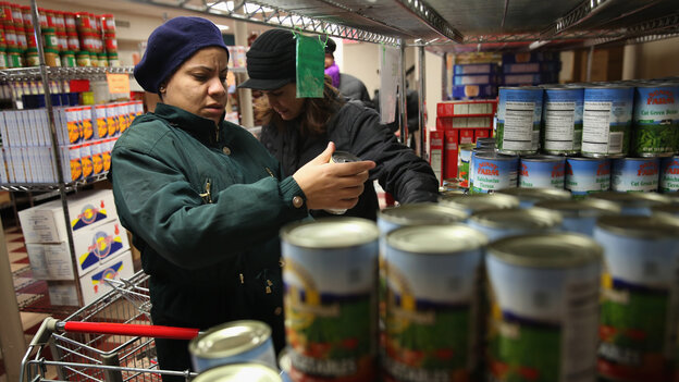 Harlem residents choose free groceries at the Food Bank For New York City in December.