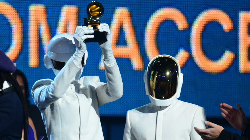 "Daft Punk won the Grammy for Album of the Year for Random Access Memories and for Record of the Year for ""Get Lucky."" (AFP/Getty Images)"