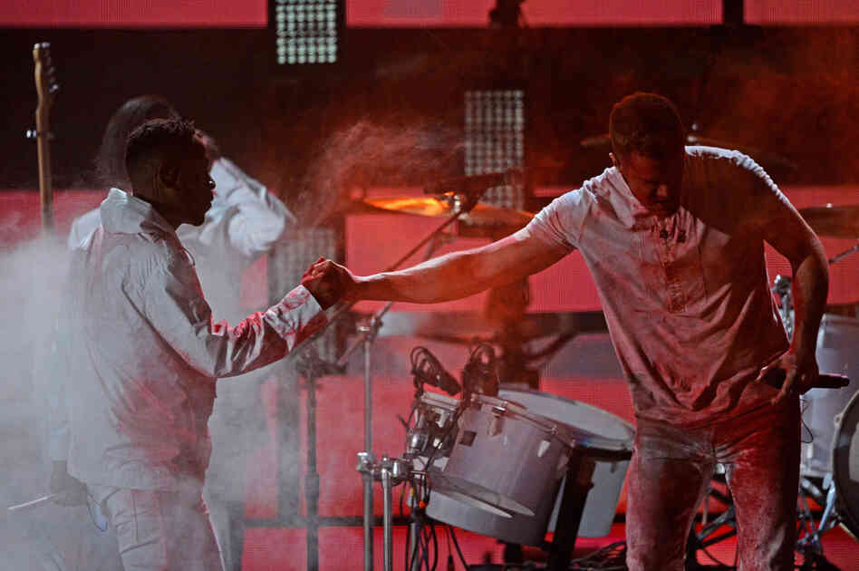Kendrick Lamar and Dan Reynolds of Imagine Dragons onstage during the 56th Grammy Awards.