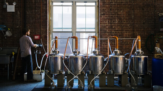 A worker at New York's Kings County Distillery, which opened in 2010. Before going legit with the operation, co-founder Colin Spoelman (not pictured) learned to make moonshine in his Brooklyn apartment without a permit.