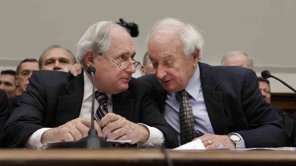 Sen. Carl Levin (left) huddles with his brother