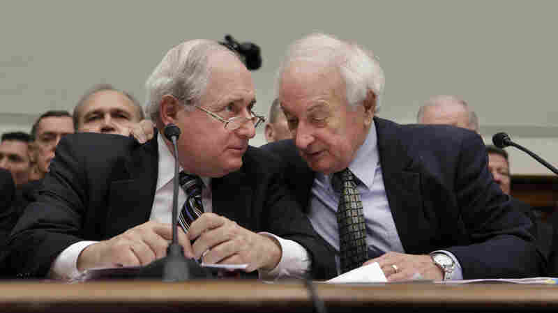 Sen. Carl Levin (left) huddles with his brother and fellow Michigan Democrat, Rep. Sandy Levin, during testimony on the automotive industry bailout in 2008.