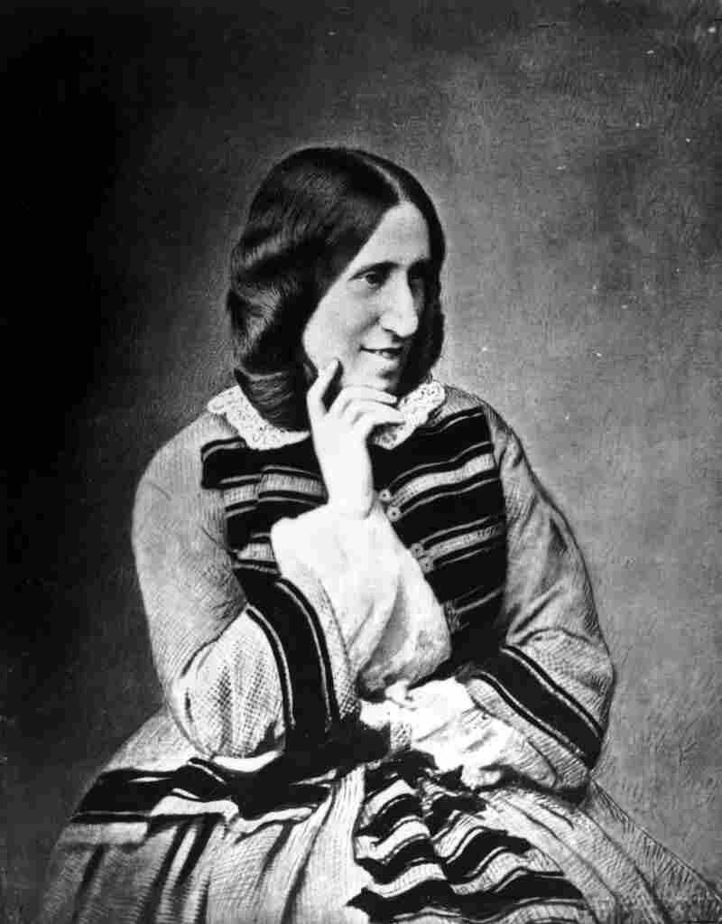 English novelist George Eliot (1819 - 1880), pseudonym of Mary Ann Evans, poses for a photograph.