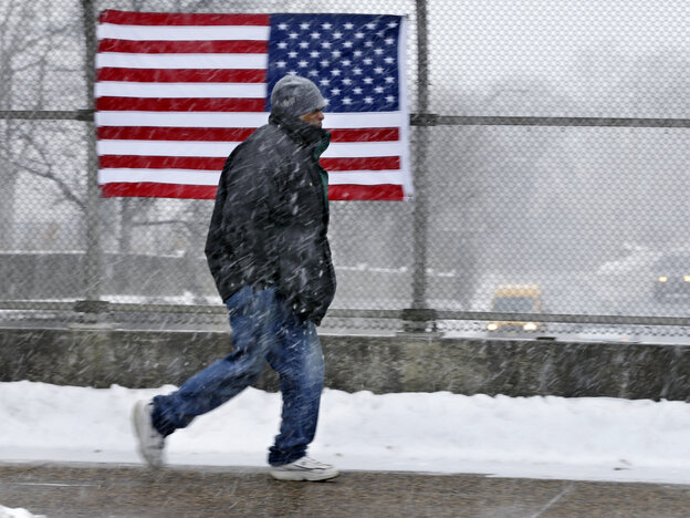 A man walks across a bridge in Trenton, N.J., on Saturday. More cold weather is headed his way.