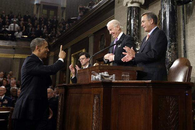President Obama gestures to Vice President Joe Biden and House Speaker John Boehner before giving his 2013 State of the Union address.