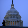 A woman bundled against the cold walks past the U.S. Capitol dome prior to President Obama's State of the Union address before a joint session of Congress on Tuesday.