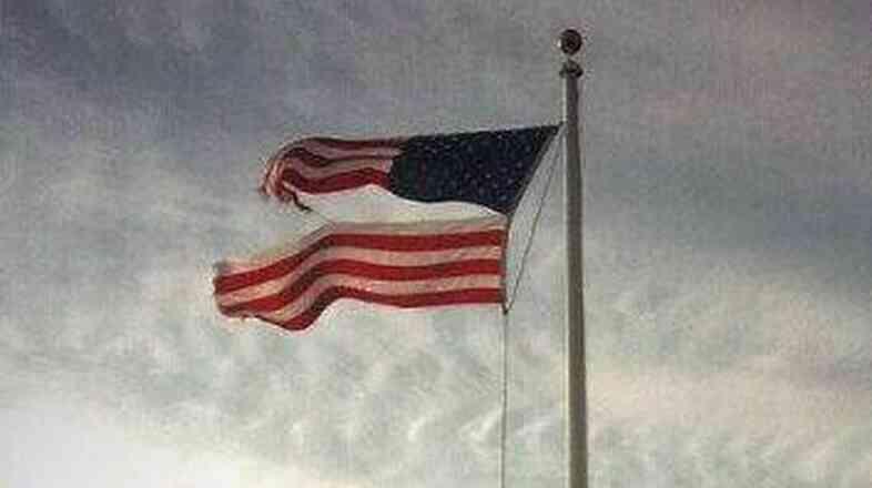 A tattered U.S. flag.