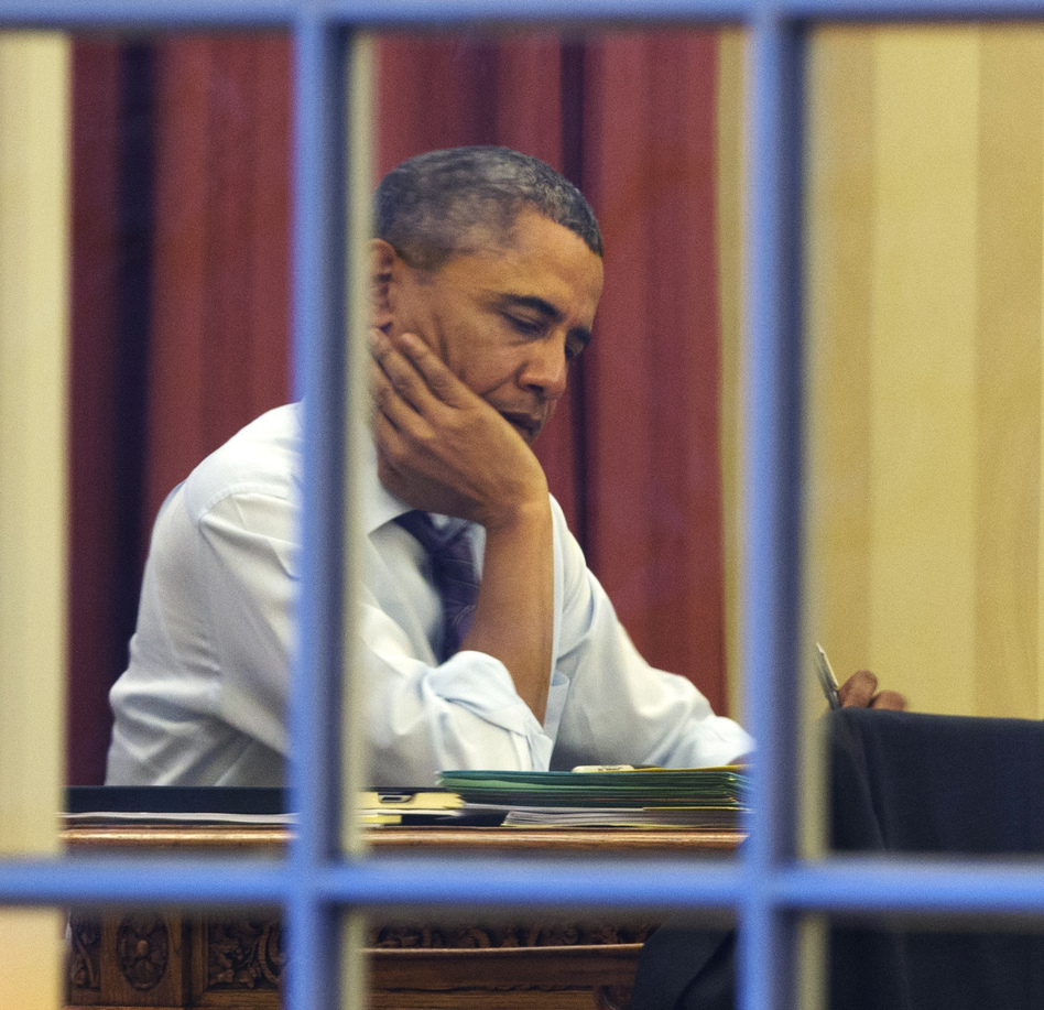 President Obama, working at his desk Monday night on the eve of his 2014 State of the Union address. (Jacquelyn Martin/AP)