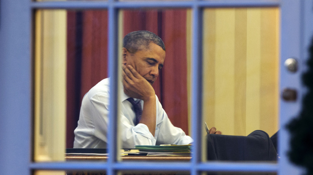 President Obama, working at his desk Monday night on the eve of his 2014 State of the Union address. (AP)