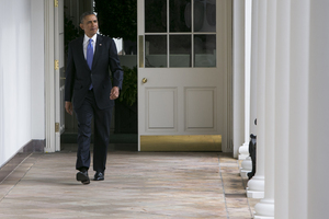 President Obama walks along the colonnade of the White House earlier on Tuesday.